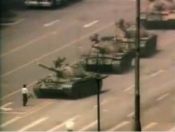 Man confronting tanks